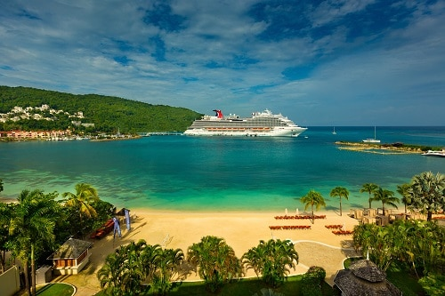 ocho rios bay beach with a carnival ship in the background