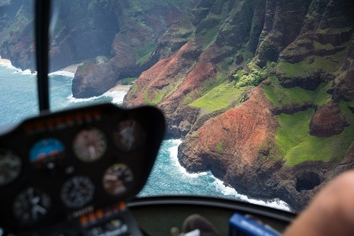 aerial view of the coast of hawaii from the cockpit of a helicopter tour