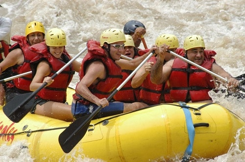group of people whitewater rafting in limon