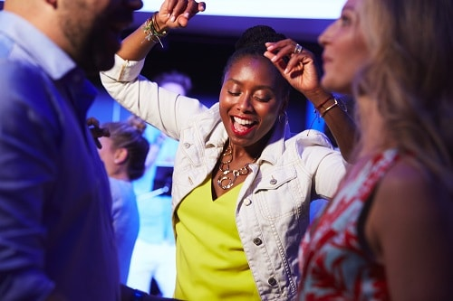 woman dancing at the new years eve after party in carnival's nightclub
