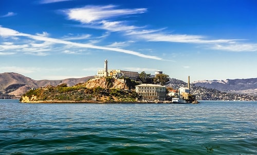 view of alcatraz island in san francisco from a boat in the bay