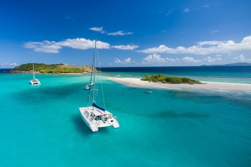 aerial view of a catamaran sailing in the eastern caribbean