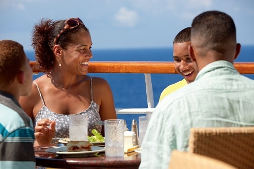 family dining on the deck of carnival spirit
