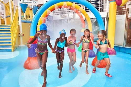 girls running around on carnival breeze's waterworks