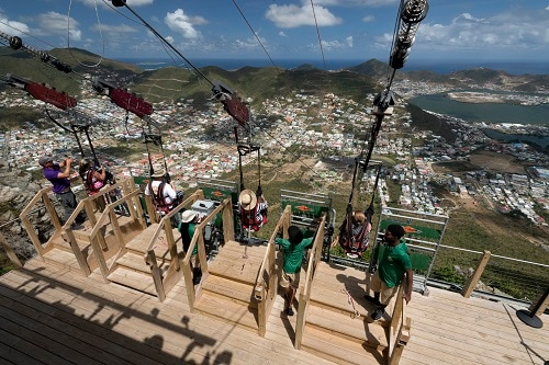 four guests getting ready to zip line down the world's steepest zip line in st maarten