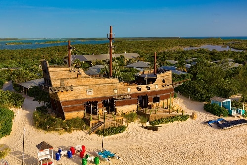 aerial view of the pirate ship docked on the beach of half moon cay