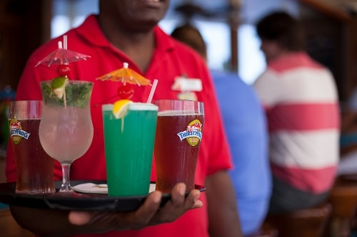redfrog bartender serving drinks onboard carnival fascination