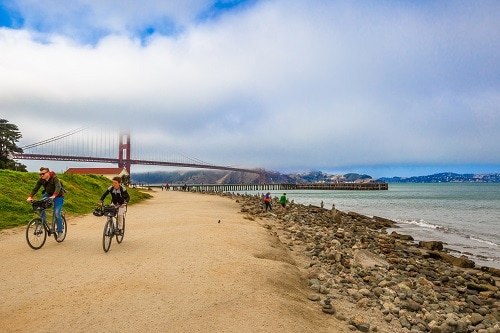 cyclists riding along the dirt roads of presidio in san francisco