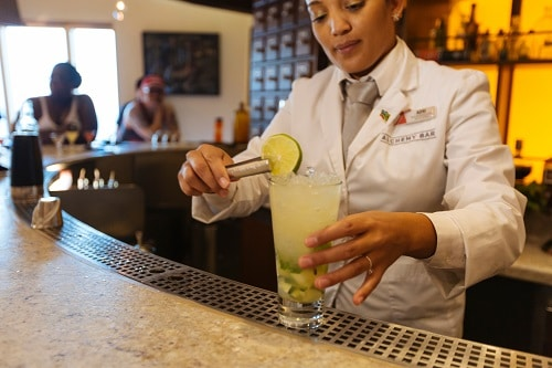 alchemy bartender onboard carnival fascination adding a lime on a drink