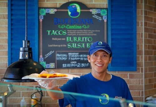 blueiguana cantina cook serving tacos onboard carnival legend