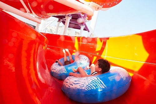 two brothers going down a water slide in of waterworks carnival vista