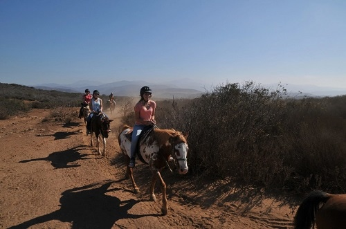 woman horseback riding on a magnificent trail in baja mexico