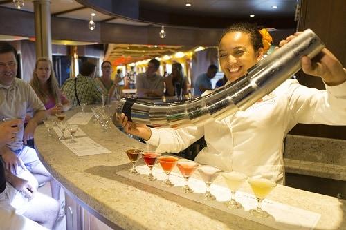 bartender preparing drinks in the alchemy bar onboard carnival horizon
