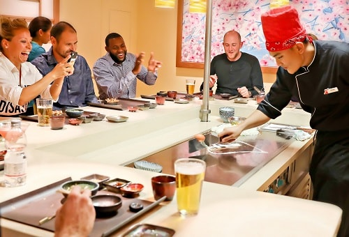 bonsai teppanyaki chef cooking in front of guests onboard carnival horizon