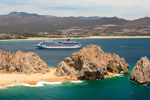 aerial view of carnival splendor sailing into cabo san lucas