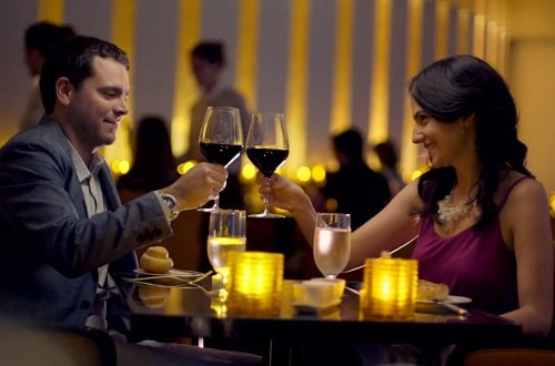 young couple having a romantic dinner onboard carnival legend
