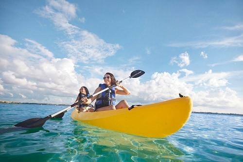 friends kayaking along the shore of the bahamas