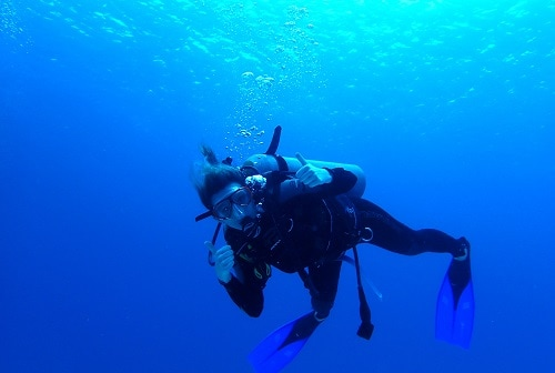man scuba diving in the caribbean