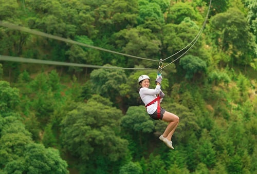 woman zip lining during a shore excursion in st lucia