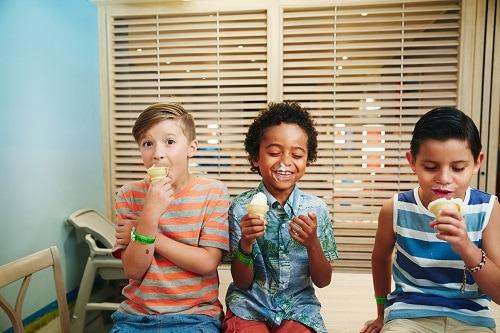 3 boys eating ice cream cones from carnival vistas swirls