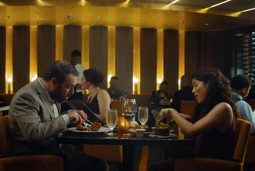 couple having a romantic dinner at fahrenheit 555 steakhouse