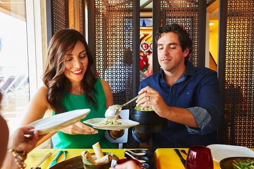 couple eating at jiji asian kitchen on board carnival horizon