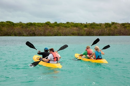 four friends kayaking in grand turk