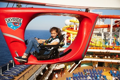 girl going over carnival vista's deck as she cycles on skyride