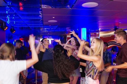teenagers dancing at carnival vista's club o2