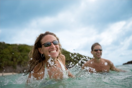 woman with sunglasses swimming in the caribbean sea during a shore excursion