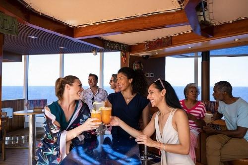 3 friends enjoying a few cocktails served at blueiguana tequila bar onboard carnival vista