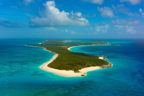 aerial view of an island in the bahamas during a bright sunny day