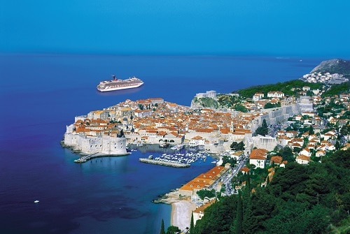 aerial view of the city of dubrovnik croatia as a carnival ship sails away