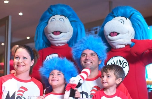 family posing with thing 1 and 2 during green eggs and ham breakfast on carnival magic