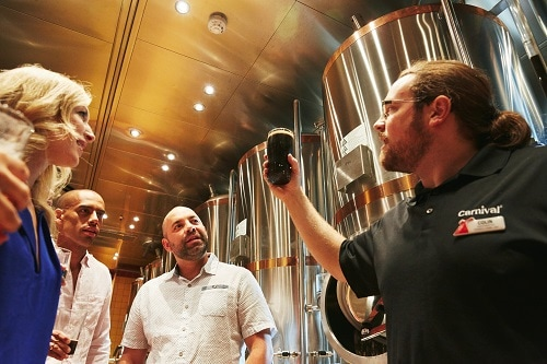 brewmaster examining fresh beer made onboard carnival vista