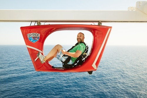man cycling high above the sea on carnival's skyride