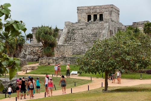guest exploring ancient mayan temples in tulum during their cruise to cozumel