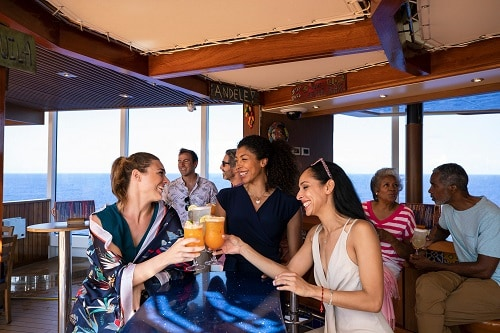 friends toasting to a good time at blueiguana bar on board carnival horizon