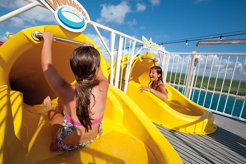 2 girls are going down waterworks slides onboard carnival fascination