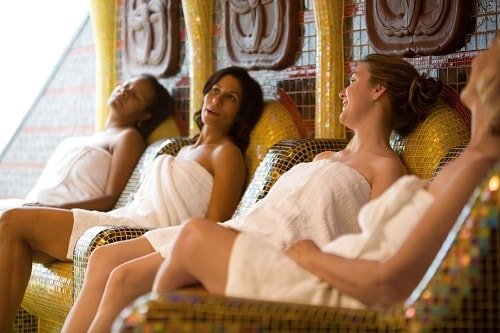 woman relaxing at spa carnival onboard carnival fascination