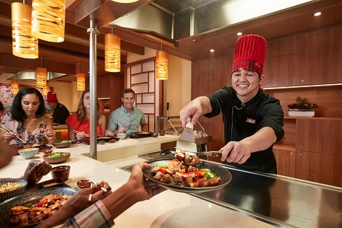 chef serving delicious pieces of steak at bonsai teppanyaki onboard a carnival cruise ship
