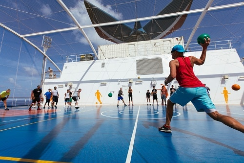 cruisers playing dodgeball on board a carnival cruise ship