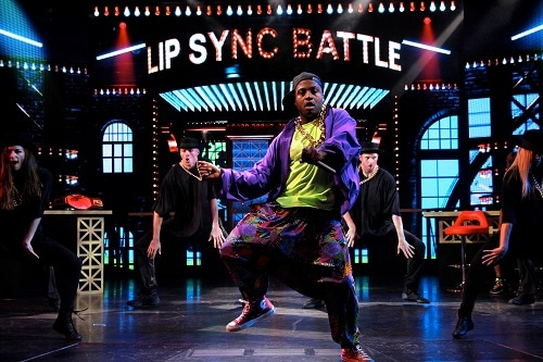 man putting on a performance at lip sync battle: carnival