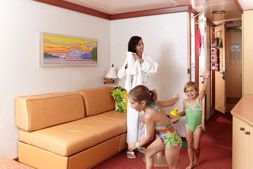 mother and her 2 daughters in their stateroom, getting ready to go to the pool on embarkation day