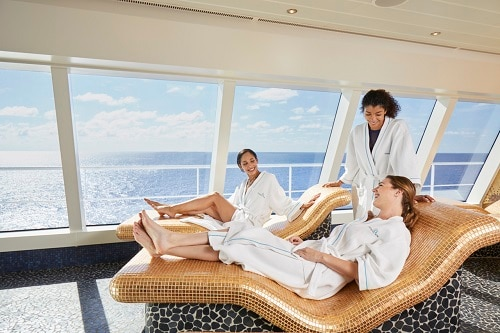friends enjoying the cloud 9 thermal lounge during their cruise vacation on embarkation day