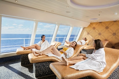 friends relaxing at the cloud 9 thermal lounge onboard a carnival cruise
