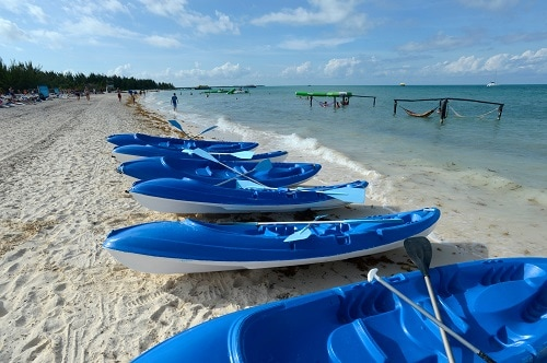 kayaks lined up at isla pasion in cozumel