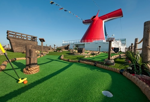 cruiser playing mini golf on board carnival elation