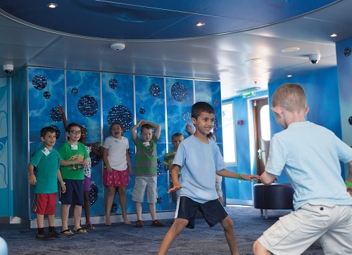 kids playing tag at camp ocean onboard a carnival cruise ship