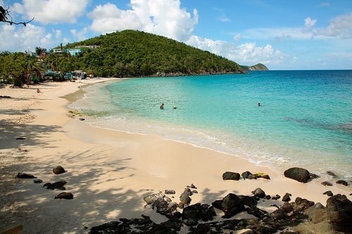 beautiful view of a beach in st thomas with a mountain backdrop